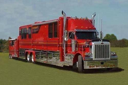 Modest custom Peterbilt RV with matching inclosed trailer.