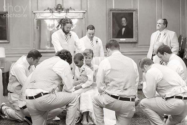 What a wonderful idea. Groomsmen pray over the bride as the bridesmaids pray over the groom. My heart melted.