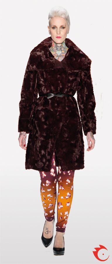 anja gockel dark purple fur jacket in combination with a orange and purple patterned pants
