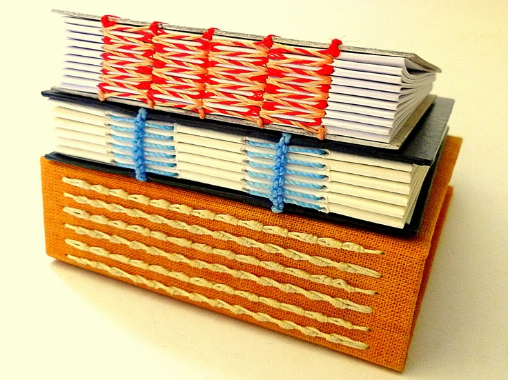 colorful stitch patterns on three types of handmade books