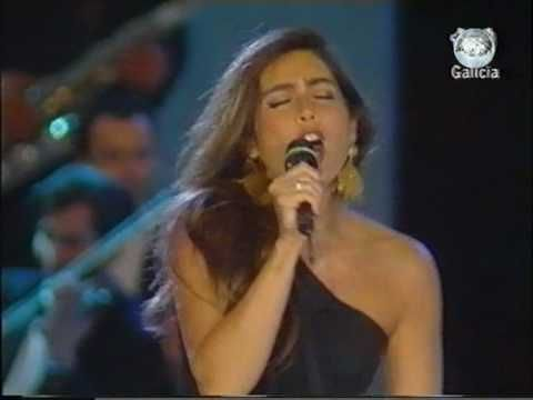 "the famed and legendary duo, Al Bano & Romina Power sing their mega-hit song, ""Felicita"" live on stage at a dinner concert in Galicia, Spain. just beautiful!! what's also beautiful is that the audience  participates and enjoys the performance by rocking out. totally pg. absolutely stunning performance!! one of my all-time favorites!! video is courtesy of www.youtube.com. listen, rock out and enjoy!! I love you romina and al bano!! stay awesome, my friends!! xoxo."