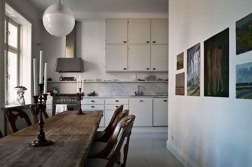 L shape gives you semi-eat in kitchen but still transitional space. Stairs on other side of the wall?
