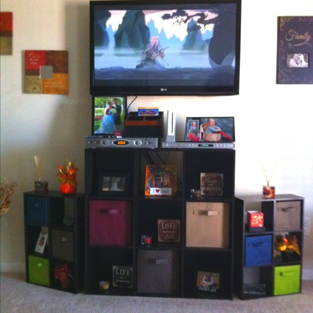 Use the 3x3 storage cubes with fabric cubes for a quick and cheap entertainment center. Accented with the smaller versions for the sides. The best part, change the color of the cubes for each season! Also, double as a DVD holder and/ or kids toys that are played with everyday in the cubes!!