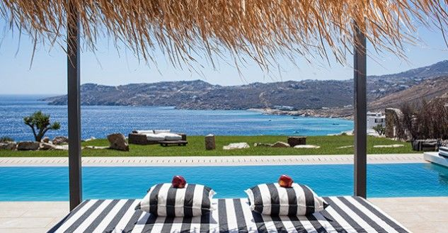 Just relax by the pool and enjoy the blue sky and the amazing view!  #LuxuryVillas #SummerInGreece #Mykonos