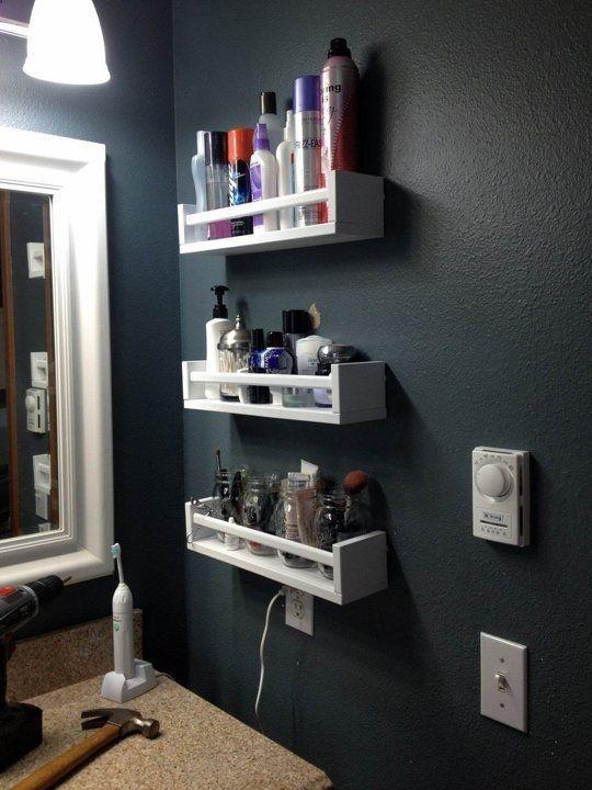 Ikea Bekvam Spice Rack in the bathroom. I especially like the mason jars holding makeup brushes.