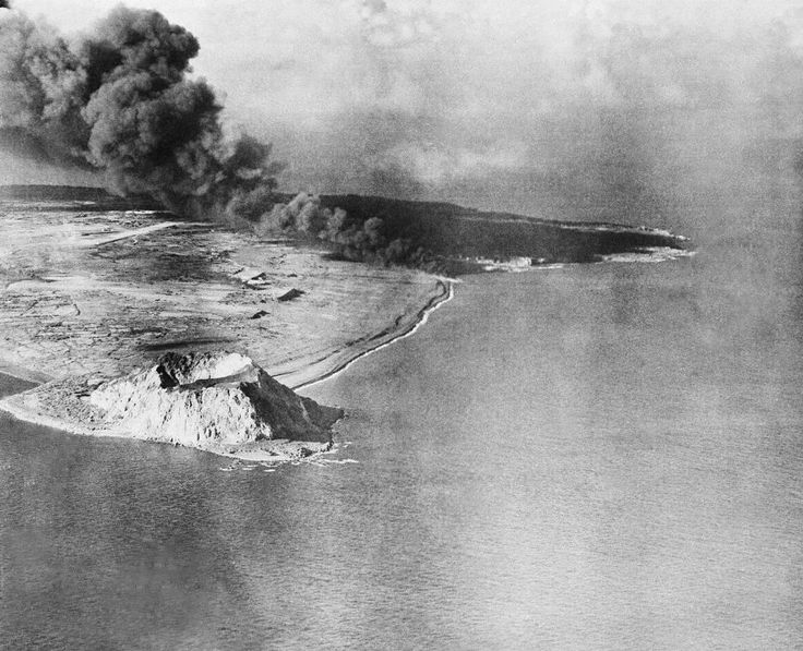 Sandy Beach stretching along southeastern edge of tip of Iwo Jima at right of Mt. Suribachi, volcano at lower left, is scene of landing of U.S. Marines on Iwo Jima.
