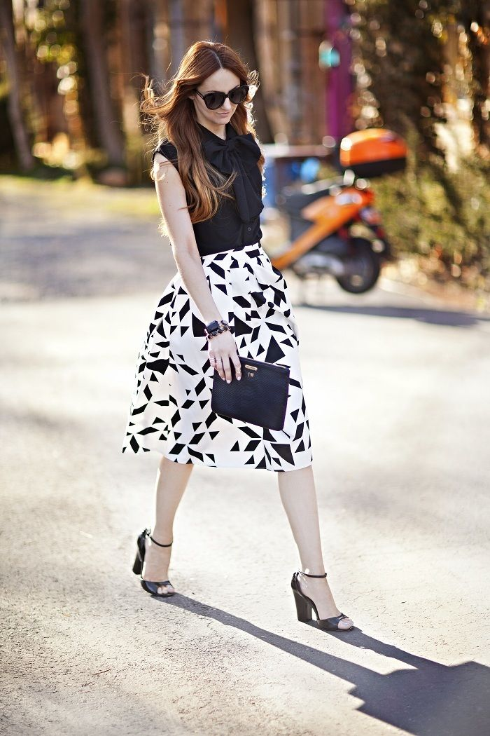For the professional yet daring, funk up your outfit with a graphic midi skirt in black and white.Photo credit: Little J Style via StyleList