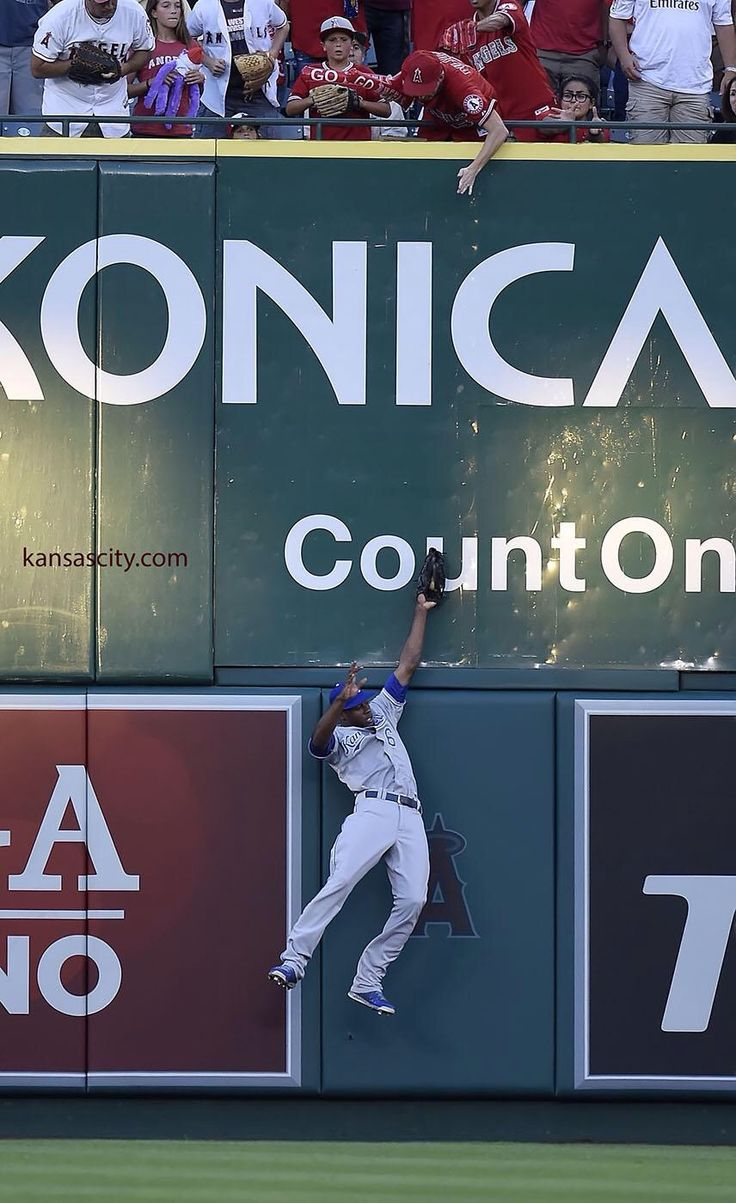 Kansas city royals center fielder lorenzo cain made a leaping catch at the wall in the first inning on a ball hit by los angeles angels right fielder kole