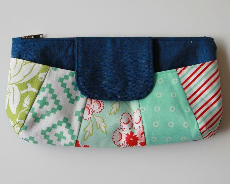 Rainbow Clutch pattern from Anna Graham's book Handmade Style. Fabrics are a selection from Bonnie and Camille.  #rainbowclutch #amygraham #handmadestyle #bonnieandcamille #sublimebabyfabrics