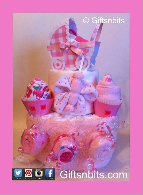 Nappy Cake contains 28 nappies & 5 gifts . Personalised Paper Pram. Available in blue & neutral . www.giftsnbits.com