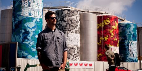Graffiti artist Askew One, aka Elliot O'Donnell, with his latest work done on the tanks at Wynyard Quarter.