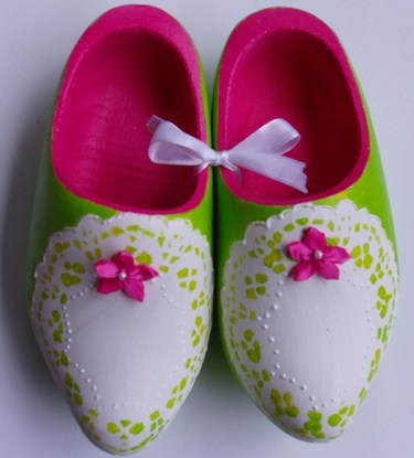 Wooden shoes painted pink 'n green. Love the lace detail. Love the little ribbon where the holes are. Very cute.