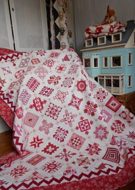 Great red & white Nearly Insane quilt by Supergoof Quilts... some great close-ups to see the fabrics