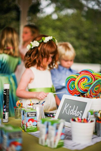 """Entertain your youngest guests by setting up a kids' VIP lounge at your wedding reception! fun activities with them, such as an """"I Spy"""" photo challenge for the older kids (provide a list of snapshots they must take) and coloring books for the younger ones. Provide kid-friendly coordinated seating (such as beanbag chairs or low couches) for a true """"lounge"""" feel"""
