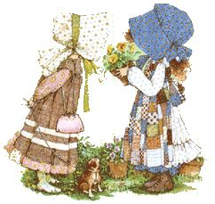 Holly Hobbie, my childhood bedroom was decorated with her, my grandmother's wall had the plates and now I have my very own Holly Hobbie room in the basement.  Love her!