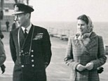 On board: In this exclusive picture before she came to the throne, the Queen joins her father King George VI on a tour of HMS Vanguard South Africa in 1947