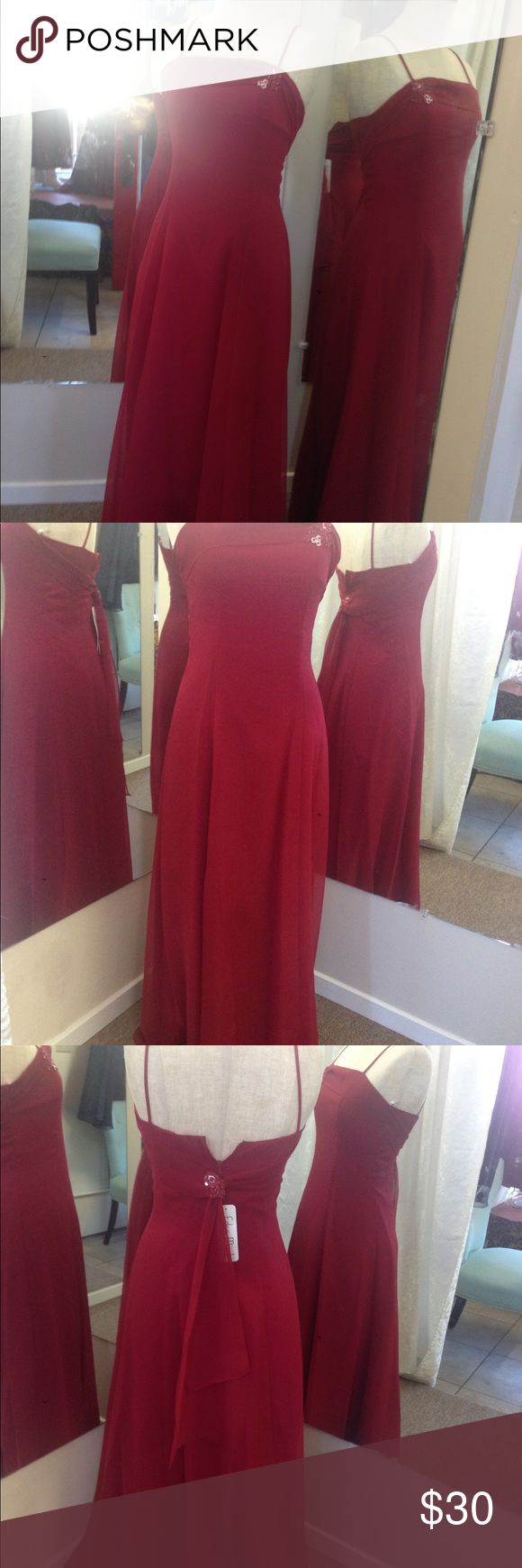 Long junior dress, cranberry  color. Beautiful junior dress sise 12. Plastic zipper on back, waist 25, bust 30 inches, hip 40 inches, long dress 52 inches longer. Eden Maids Dresses Strapless