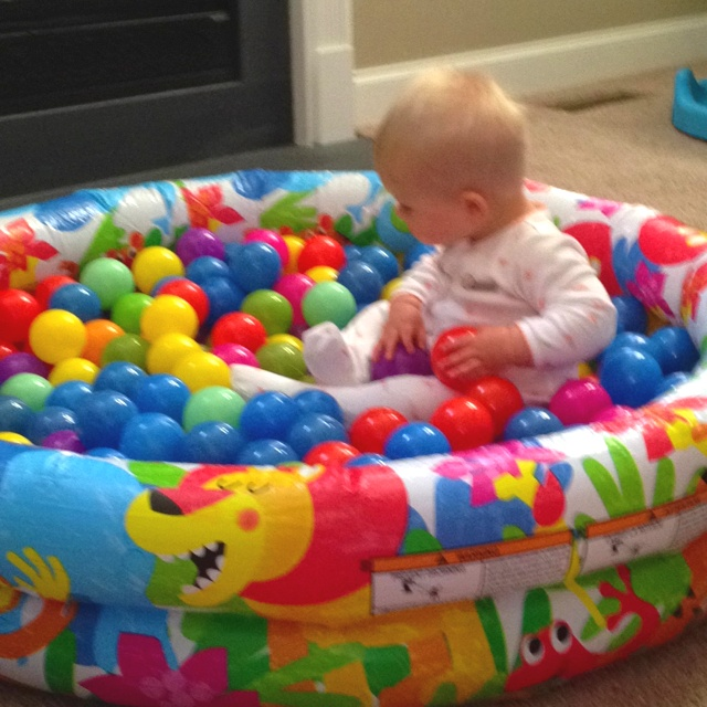 Home made ball pit blow up plastic baby pool and balls from Walmart or Target.
