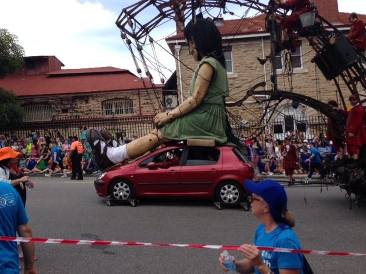 The little girl rides on a car on Hay Street, Perth.
