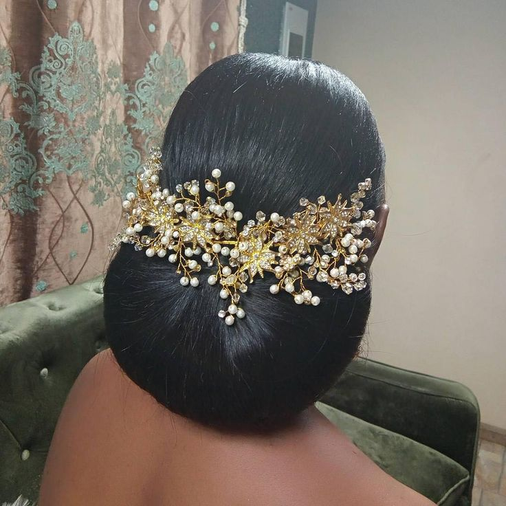 ✨✨  Stunner bride, Prisca and her wedding hair goals!  Hair by @tobbiestouch  Accessories by @zenaaccessories  Event planned by @stopgapevents  #BellaNaijaWeddings