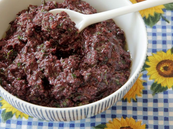 Tapenade is a condiment made with puréed or finely chopped olives, capers,  anchovies, and olive oil. Its name comes from the French word for capers,  tapenas. Well before the French fell in love with tapenade, the ancient  Romans made olive-based tapenades with anchovies. Recipes were first found  in Roman cuisine from the first century A.D.! Some foods seem to always  satisfy.  Prep time: 15 min • Yield: A little over 1 cup  Equipment      * Food processor…