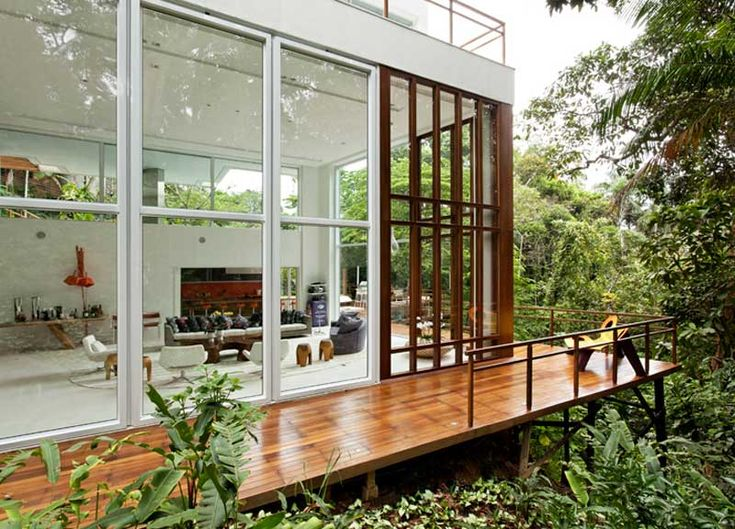 A Modern House Made Mostly Of Concrete And Glass