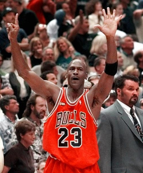Chicago Bulls guard Michael Jordan holds up six fingers for the six NBA Championships the Bulls have won after Chicago defeated 87-86 in Salt Lake City, Sunday, June 14, 1998. (AP Photo/Mark J. Terrill).