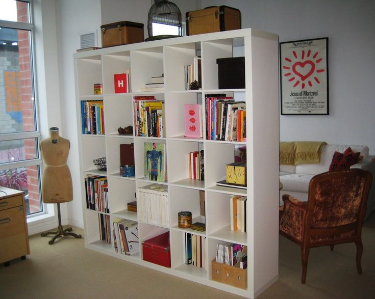 Bookshelves as a divider. Would put casters on all so could use in tiny house could change up room sizes as needed.