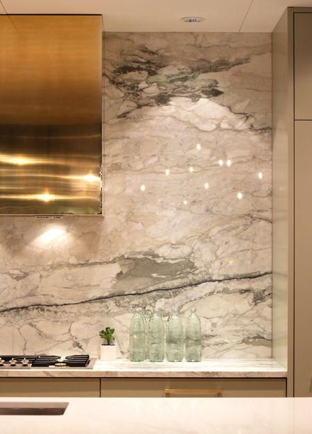 Kitchen backsplash - marble, gold hood