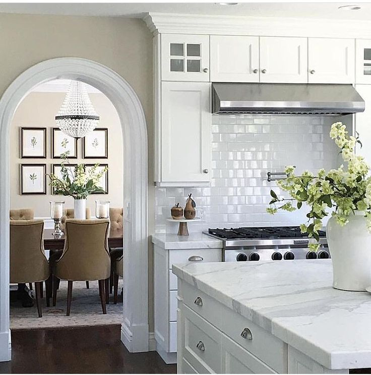 White kitchen with glossy subway tile backsplash