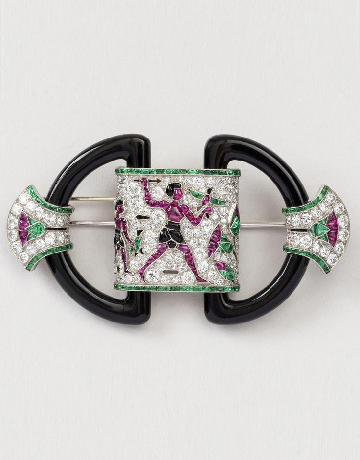 Chaumet - An Art Deco Egyptian Revival platinum, diamond and gem-set brooch, circa 1924. Contains diamonds, rubies, emeralds and onyx. #Chaumet #ArtDeco