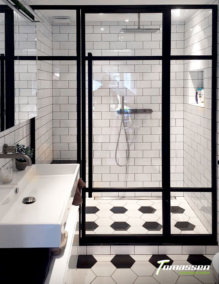 Glass doors, black and white bathroom