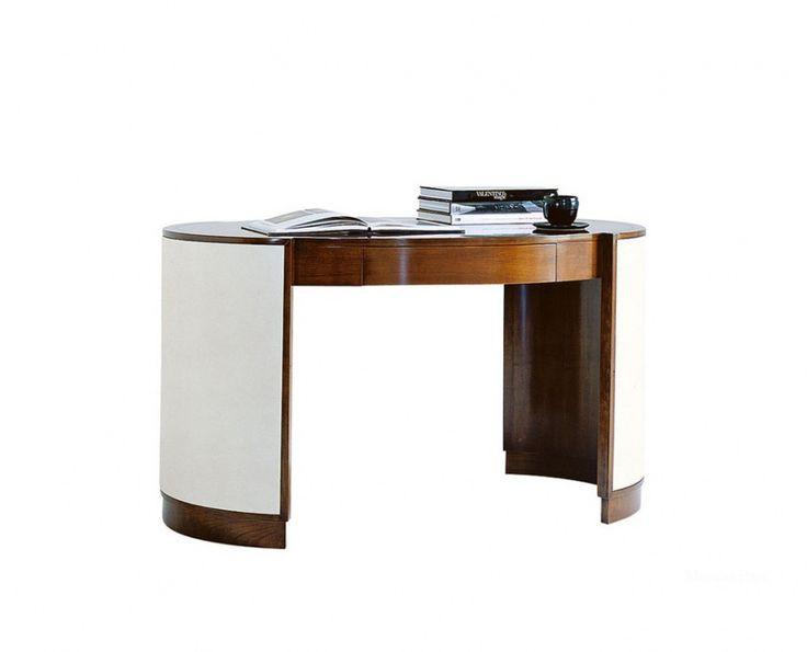 Овальный письменный стол Victor от итальянского производителя Selva. Каркас выполнен из шпона вишни. Модель с одним выдвижным ящиком. Боковые части стола обтянуты белой кожей. Стол выполнен в стиле арт деко.