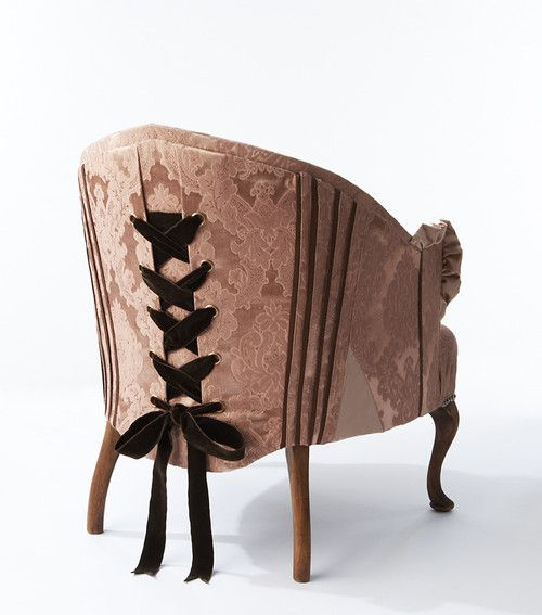 Great way to cover up the fact that I'm not very good at recovering furniture! I can lace up the back of the fabric!