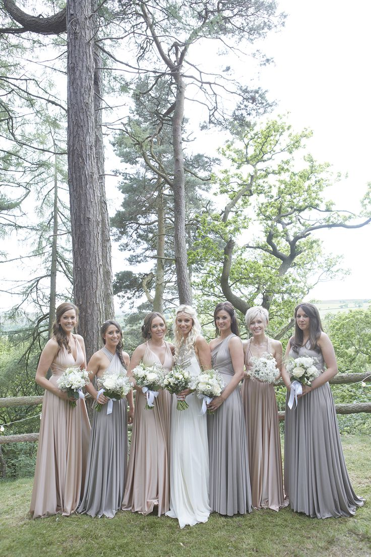 Bridesmaids in neutral toned (soft rose water and putty blend) twobirds bridesmaid dresses -   Image by Natalie J Weddings - Bride in an Amanda Wakeley Wedding Dress & Sigerson Morrison Shoes. Neutral twobirds Bridesmaid dresses &  Groom in a Reiss Suit for a stunning marquee reception.