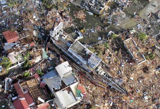Trail of devastation |  An aerial view of devastation and a ship after it was swept at the height of super typhoon Haiyan in Tacloban city in central Philippines November 9, 2013, in this handout provided by Philippine Air Force.  Photo: Reuters/Lt Col Gaudie Lauron/Philippine Air Force/ Metro.co.uk