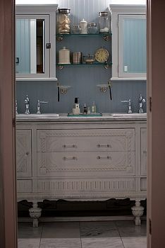 Isn't this a beautiful bathroom? Love the color scheme and antique furniture.