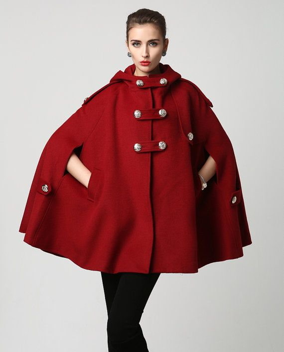 How gorgeous is this classic red wood cape with hood, hip pockets and large silver button details, A cape is always great for a fall coat, but also a