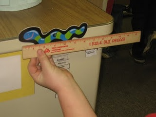 Hide inch worms around the room.  Instruct students to find them and measure them to the nearest inc.  Cute!