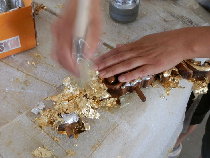 Each #gold leaf is a square 10x10 cm. Before the wood is to be worked on, it should be prepared. It can be done in different ways, we use water #gliding. Thin coating consists of the bole (a red, grey or black paste) that is mixed with an animal glue. The color of the gold dipends on the color of the bole. The bole mixed with animal glue is applied in 2 coatings. The surface should be dried up but not completely, only an experienced glider is able to define the correct moment to apply gold.