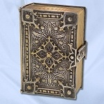 English Book Box  Silver plated Book Box embellished with Scottish influenced (thistle motifs) Gothic patterns. The spine is monogrammed 'SM. Red velvet lining is embossed 'Fisher in a crown logo from London. Circa 1900.