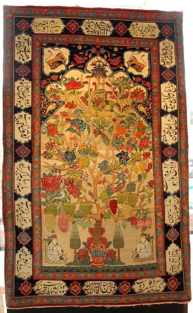 Beautiful Kerman mihrab rug with asymmetrical Tree of Life motif, displayed at the 2015 International Conference on Oriental Carpets | Jozan.net