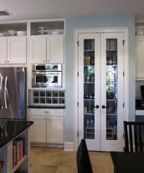 Built In Wine Storage Cabinetry And Pantry With Slim Narrow French Doors