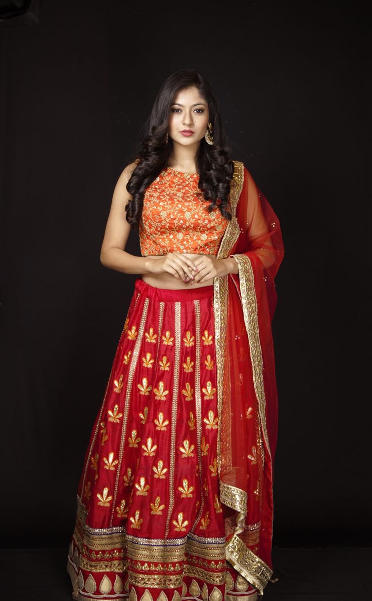A bright red and orange lehenga complimented with a beautifully crafted gotapatti work, this color combination looks graceful as ever!! Log on to www.rentanattire.com & check out the newly added collection. #RentAnAttire #DifferentIsBeautiful #BookitFlauntitReturnit <3