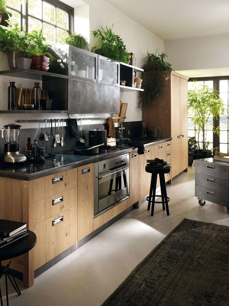Diesel Social Kitchen design by Diesel.  Vintage and innovation? Materials and finishes all have that well-used look: steel is aged, and the types of wood used are all processed to convey a time-worn look and feel; the wired glass and handles reinforce this retro concept.