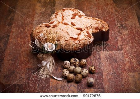 Sold! Stock photo available for sale at Shutterstock: Traditional Italian desserts for Easter - Easter dove (COLOMBA PASQUALE) and quail eggs, on wood table.