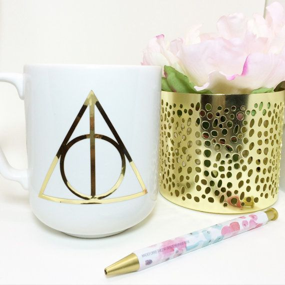 This simple Deathly Hallows mug is all you'll need to feel powerful — well, plus your morning cup of tea. | 15 Harry Potter Mugs