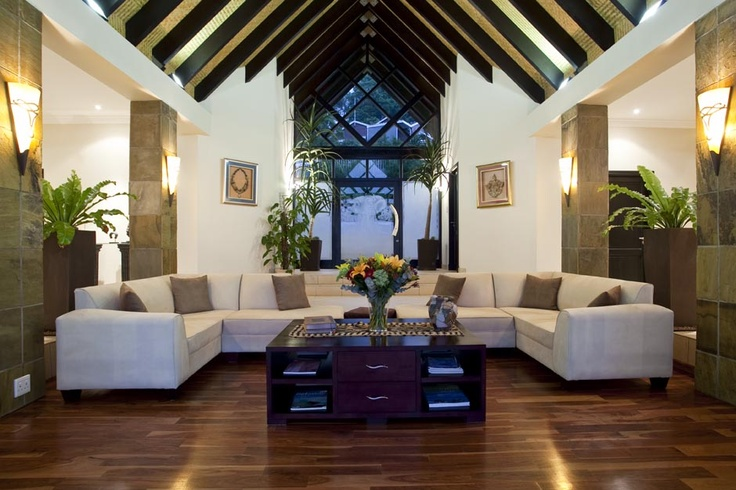 Double volume living area, with wooden floors and ceiling detail.