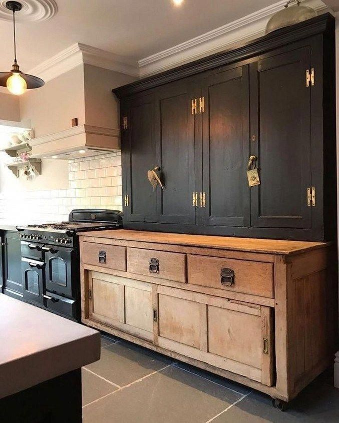 Almost black paint on lower cabinets against stone walls ...