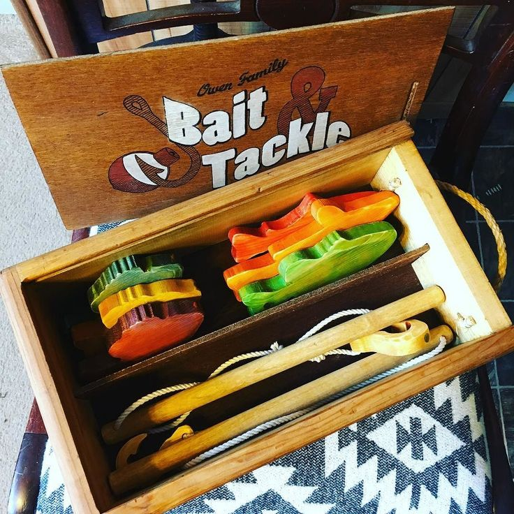A birthday present for my favorite nephew! Fish and fishing poles #yougetalineillgetapole #repurposed #foodcolor #woodstain #magneticfishing #kidstoys #winebox #woodworking #scrollsaw #fishing